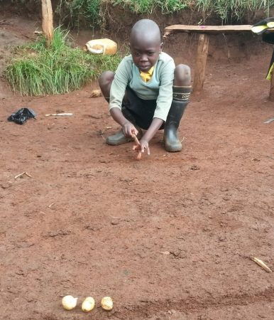 Now that he can see clearly, Meshack is able to play outside again, just like other boys his age.