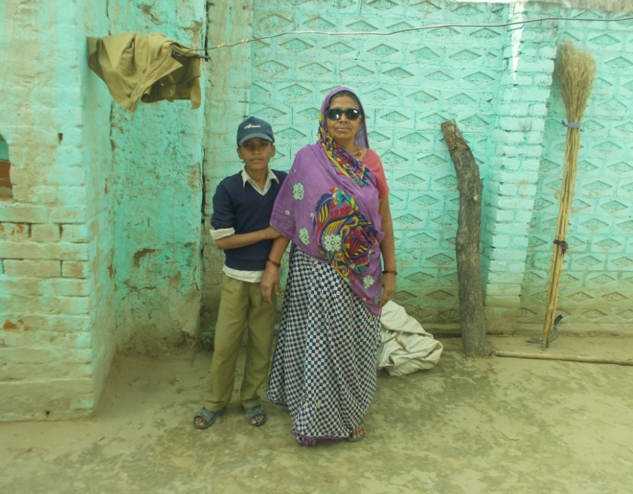Blind Indian grandmother with her grandson.