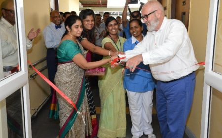 Foster (right) is shown here cutting the ribbon to inaugurate the Operation Eyesight Institute for Eye Cancer at LV Prasad Institute in Hyderabad, India in 2015.